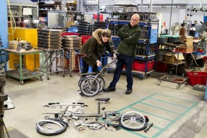 Programme Name: Inside the Factory - TX: n/a - Episode: Bicycles (No. 4) - Picture Shows: assembling a Brompton bike Cherry Healey, Gregg Wallace - (C) Voltage TV  - Photographer: Chris Parkin